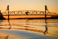 Steel Draw Bridge over a River at Sunset royalty free stock photography