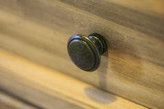 Steel drawer handle in a vintage furniture Royalty Free Stock Photography