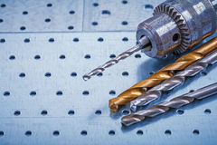 Steel drill with boring bits on perforated Royalty Free Stock Photos