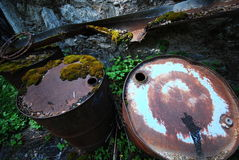 Steel drums polluting nature Royalty Free Stock Photos