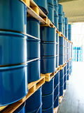 Steel drums stored in warehouse Stock Images