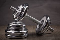 Steel dumbbell and weights. Royalty Free Stock Photo