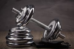 Steel dumbbell and weights. Stock Image