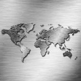 Steel Earth map over old aluminium desk Stock Photography