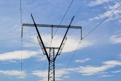 Steel electric pylon against the blue sky. stock image