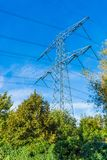 Steel electricity power tower construction in a nature landscape with blue sky. A steel electricity power tower construction in a nature landscape with blue sky stock photography