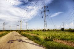 Steel electricity pylon on bright blue sky Royalty Free Stock Photo