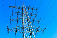 Steel electricity pylon under bright blue sky Royalty Free Stock Photo