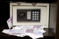 Steel electronic safe with money. Little steel electronic safe with money (500 euro banknotes). bank safe with the digital lock add million (1000000) euro Royalty Free Stock Photo