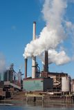 Steel factory with big chimneys in the Netherlands Royalty Free Stock Photo