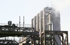 Steel factory with chimneys and white smoke Stock Photography