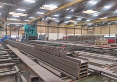 Steel factory. Steel construction beams at workshop are manufactured in a metal factory Stock Photo