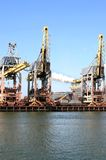 Steel factory and cranes in Holland Royalty Free Stock Photos
