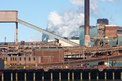 Steel factory with smokestack in the Netherlands Stock Images