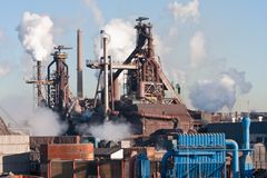 Steel factory with smokestacks Stock Photo