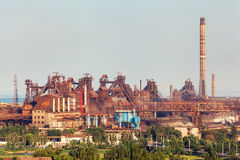 Steel factory with smokestacks at sunset Royalty Free Stock Image