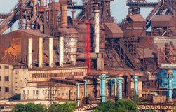 Steel factory with smokestacks at sunset. Rusty steel factory with smokestacks at sunset. metallurgical plant. steelworks, iron works. Heavy industry in Europe Stock Images