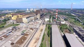 Steel factory with smokestacks at suny day.Metallurgical plant. steelworks, iron works. Heavy industry in Europe.Air pollution fro stock footage
