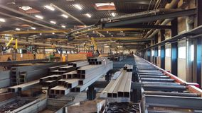 Steel factory workshop. Steel construction beams at workshop are manufactured in a metal factory royalty free stock images