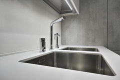 Steel faucet for a modern kitchen Royalty Free Stock Photo