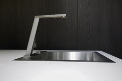 Steel faucet for a modern kitchen Stock Image