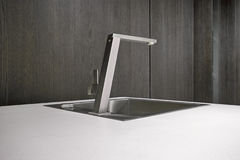 Steel faucet for a modern kitchen Stock Photos