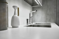 Steel faucet for a modern kitchen. Modern steel faucet in the kitchen royalty free stock image