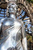 Steel female statue. Closeup view of a steel female statue in an outdoor setting Stock Photography