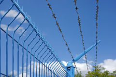 Steel fence with barbed wire Royalty Free Stock Photos