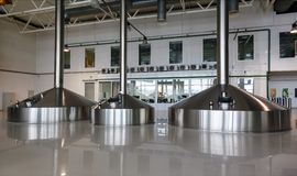 Steel fermentation vats on brewer factory Royalty Free Stock Photography