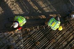 Aerial view of steel workers at work Royalty Free Stock Photo