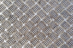 Steel floor plate. Heavy used diamond plate industrial metal floor Royalty Free Stock Image