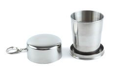 Steel folding cup near cover with key ring Royalty Free Stock Photography