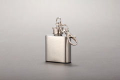 Steel folding cup near cover with key ring. On black background Royalty Free Stock Image
