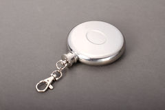 Steel folding cup near cover with key ring Stock Photo