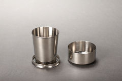 Steel folding cup. Stainless steel flagon Stock Photography