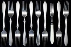 Steel fork  on a black background. Set of steel forks on a black background Royalty Free Stock Images