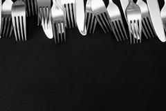 Steel fork  on a black background. Set of steel forks on a black background Royalty Free Stock Photo