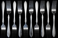 Steel fork  on a black background Stock Photography