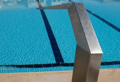 Steel fountain near the pool, wonderful outdoor sports royalty free stock photography