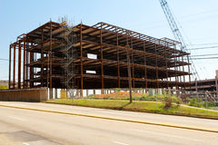 Steel Frame Building Construction Site in a City. A four-story, steel framed, commercial building construction site in a metropolitan city in the USA. A Royalty Free Stock Image