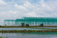 Steel frame building under construction and cloud blue sky, background. Steel frame building under construction and cloud blue sky Royalty Free Stock Images