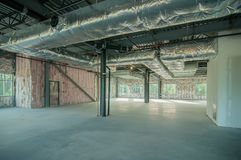 Steel frame construction project unfinished. Exposed interior structure of unfinished construction project royalty free stock photos