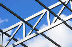 Steel frame of the factory roof. Steel frame of the factory roof in construction Stock Photo