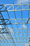 Steel frame of the factory roof. Stock Photos