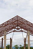 Steel frame of house roof. Under construction stock photography