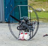 A metal contraption with a gas engine being used for paragliding Royalty Free Stock Photos