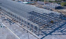 The steel frame structure is under construction stock photo