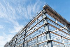 Steel frame workshop is under construction. Against a blue sky Royalty Free Stock Photo