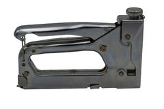 Steel furniture stapler. Isolate on white background. stock photo